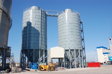 2 No 12.5m Dia. x 2600m3 bulk silos with roof mounted penthouses.